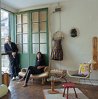 Portrait of designers Dipa Joshi and Jonathan Levien in the living area of their warehouse