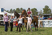 Flat Top (left) in winners circle with Bounding Cat, jockey Robbie Walsh, trainer Janet Elliot, and Allison Fulmer (center), and Britt Graham (left), Aiken Spring Races 2009.