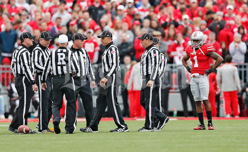 Ohio State Buckeyes cornerback Bradley Roby (1) watches as refs confer about his tackle of Iowa Hawkeyes tight end C.J. Fiedorowicz (86) in the first  half at Ohio Stadium on October 19, 2013.  (Chris Russell/Dispatch Photo)