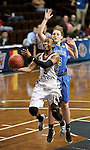 SIOUX FALLS MARCH 22:  Kiana Johnson #3 from Virginia Union takes the ball to the basket against Victoria Lux #32 from Bentley University during their quarterfinal game at the NCAA Women's Division II Elite 8 Tournament at the Sanford Pentagon in Sioux Falls, S.D.  (Photo by Dave Eggen/Inertia)