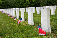 NEW YORK, NY - MAY 25: View of some graves of American soldiers with U.S flags at the Cypress Hill Military Cemetery on May 25, 2020 in Brooklyn, NY. Memorial Day is an American holiday that commemorates the men and women who died while serving in the United States Army. Today this date is celebrated during the Covid-19 pandemic that has caused thousands of deaths in the United States and around the world. (Photo by Pablo Monsalve / VIEWpress)