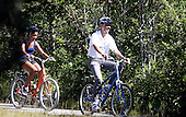 Malia Obama trails United States President Barack Obama during a family bike ride in Manuel Correllus State Forest in West Tisbury, Massachusetts, Friday, August 27, 2010. First Lady Michelle Obama and daughter Sasha were ahead by about 30 seconds. .Credit: Vincent DeWitt - Pool via CNP