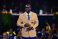Canton, Ohio - August 2, 2019:  Ty Law receives his Hall of Fame Gold Jacket from his friend Byron Washington at the Canton Civic Center in Canton, Ohio August 2, 2019.  (Photo by Don Baxter/Media Images International)