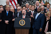 Chair of the United States House of Representatives Ways and Means Committee Kevin Brady, Republican of Texas, speaks on the South Lawn of the White House surrounded by United States President Donald J. Trump, United States Vice President Mike Pence, and Republican members of Congress after the United States Congress passed the Republican sponsored tax reform bill, the 'Tax Cuts and Jobs Act' in Washington, D.C. on December 20th, 2017. Credit: Alex Edelman / CNP