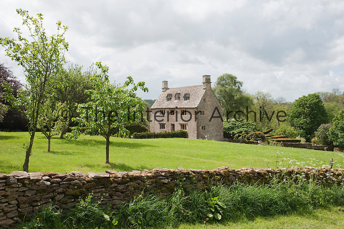The stone-built 17th century Jacobean house is surrounded by extensive grounds