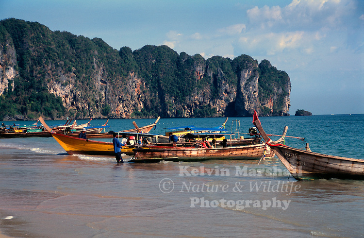 The long-tail boat, known as Ruea Hang Yao is a type of watercraft native to Southeast Asia, which uses a common automotive engine as a readily available and maintainable powerplant. A craft designed to carry passengers on a river may include a lightweight long canoe hull, up to 30 metres, and a canopy. There is much variation among these boats, some have evolved from traditional craft types, while others have a more improvised look—the sole defining characteristic is a secondhand car or truck engine. Ao Nang, Krabi Province - Thailand.