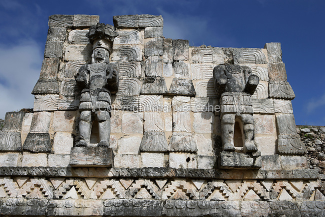 "Standing Atlantes, Eastern façade of Codz Poop (""Rolled-up matting"" in Maya), Latticework and carved panels, Puuc Architecture, 700-900 AD, Kabah, Yucatan, Mexico. Picture by Manuel Cohen"