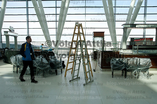 Workers perform finishing touches in progress on the new Skycourt building at the Budapest Airport in Budapest, Hungary on March 08, 2011. ATTILA VOLGYI
