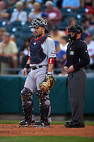Pawtucket Red Sox catcher Sandy Leon (41) and umpire Ian Fazio during a game against the Buffalo Bisons on August 28, 2015 at Coca-Cola Field in Buffalo, New York.  Pawtucket defeated Buffalo 7-6.  (Mike Janes/Four Seam Images)