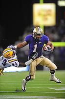Sept. 5, 2009; Seattle, WA, USA; Washington Huskies tailback (1) Chris Polk stiff arms LSU Tigers safety (44) Danny McCray in the first half at Husky Stadium. Mandatory Credit: Mark J. Rebilas-