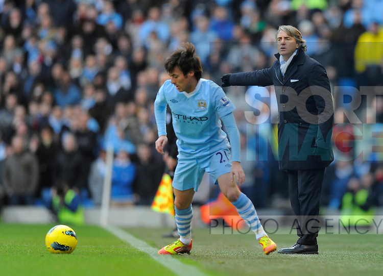 Roberto Mancini manager of Manchester City shouts instructions as David Silva of Manchester City controls the ball.Barclays Premier League.Manchester City v Tottenham at the Eithad Stadium, Manchester 22nd January, 2012..Sportimage +44 7980659747.picturedesk@sportimage.co.uk.http://www.sportimage.co.uk/.Editorial use only. Maximum 45 images during a match. No video emulation or promotion as 'live'. No use in games, competitions, merchandise, betting or single club/player services. No use with unofficial audio, video, data, fixtures or club/league logos.