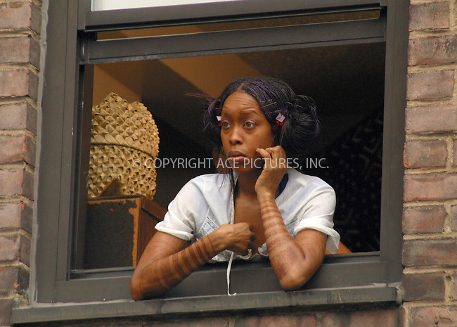 Hip Hop artist ERYKAH BADU filming scenes for her music video at Walt Whitman Housing Development on Flushing Avenue in Brooklyn. New York, August 23, 2002. Please byline: Alecsey Boldeskul/NY Photo Press.   ..*PAY-PER-USE*      ....NY Photo Press:  ..phone (646) 267-6913;   ..e-mail: info@nyphotopress.com