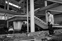 December 6th 2007, the last day before the destruction of the Preah Suramarith theatre. Artist Thyda Nop is wandering inside the building, Phnom Penh, Cambodia - 2007