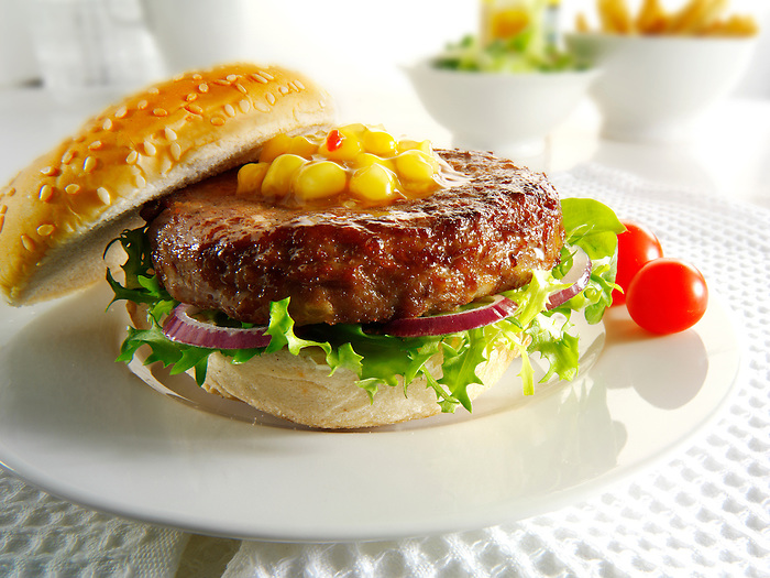 beef burger with sweetcorn relish and salad in a bun photos. Funky Stock Photos