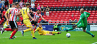 Lincoln City's Matt Green watches as his shot goes past Morecambe's Barry Roche but ends up just wide of the post<br /> <br /> Photographer Chris Vaughan/CameraSport<br /> <br /> The EFL Sky Bet League Two - Lincoln City v Morecambe - Saturday August 12th 2017 - Sincil Bank - Lincoln<br /> <br /> World Copyright &copy; 2017 CameraSport. All rights reserved. 43 Linden Ave. Countesthorpe. Leicester. England. LE8 5PG - Tel: +44 (0) 116 277 4147 - admin@camerasport.com - www.camerasport.com
