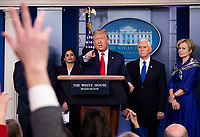 United States President Donald J. Trump delivers remakes on the COVID-19 (Coronavirus) pandemic during a Coronavirus Task Force briefing in the Brady Press Briefing Room at the White House in Washington, DC, March 18, 2020, in Washington, D.C. Standing behind the President are Seema Verma, Administrator, Centers for Medicare and Medicaid Services, left, US Vice President Mike Pence, right center, and Dr. Deborah L. Birx, White House Coronavirus Response Coordinator.<br /> Credit: Kevin Dietsch / Pool via CNP/AdMedia