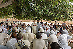 Members of the AMP movement from different villages gather for a meeting to discuss the state of the movement and the challenges it faces after the arrest of most all of its leadership. Leaders like Mehr Abdul Sattar, Nadeem Ashraf, and Shabir Sajjad have been held on 'terrorism' charges, being denied bail, locked in solitary confinement, all in an attempt to break the back of this movement. The AMP has fought the military for the rights to this land for over sixteen years, and the military is increasingly getting desperate and resorting to the use of greater violence and draconian legal procedures to finally displace the peasants and wrest control fo the land itself.