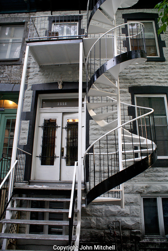 Black and white metal spiral staircase of an old house in Montreal, Quebec, Canada