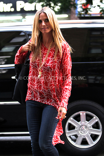 WWW.ACEPIXS.COM<br /> <br /> July 8 2013, New York City<br /> <br /> TV personality Heidi Klum arriving at a dowtown hotel on July 8 2013 in New York City<br /> <br /> By Line: Nancy Rivera/ACE Pictures<br /> <br /> <br /> ACE Pictures, Inc.<br /> tel: 646 769 0430<br /> Email: info@acepixs.com<br /> www.acepixs.com