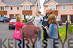 Reporters talk to neighbour of Jolanta Lubiene, Artur Libera at Langord Downs on Monday.