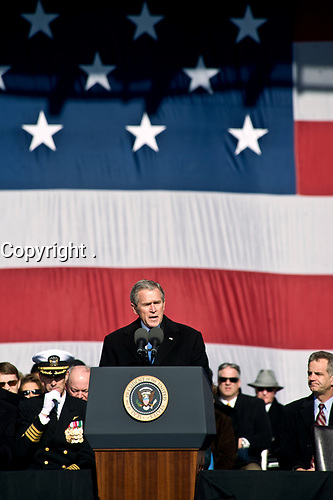 President George W. Bush speaks during the commissioning ceremony of the Nimitz-class nuclear powered aircraft carrier USS George H. W. Bush (CVN 77) at Naval Station Norfolk, Va., Jan. 10, 2009. The ship's namesake and Bush's father, President George H.W. Bush, also attended the ceremony. (DoD photo by Cherie Cullen/Released)
