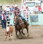Fallon's Neal Howard lasso's the calf in the 50-60 age group of the 2007 Fallon Senior Pro Rodeo.