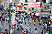 Crowds fill the streets on St. Patrick's Day at the 2011 SXSW Music Festival in downtown Austin, Texas.