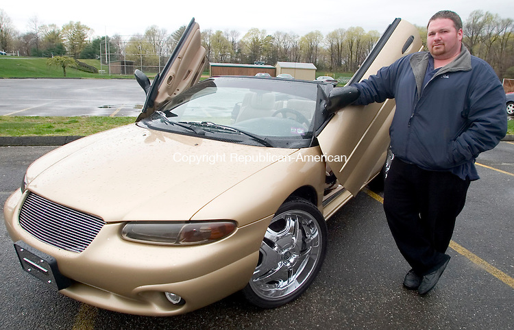 WATERBURY, CT -22 APRIL 2006 -042306JT16--<br /> Rob Tuttle, from All 4 Show in Waterbury, with co-worker Rob Lopez' 1997 Chrysler Sebring.<br /> 203-465-0104<br /> Josalee Thrift Republican-American