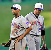 New York Mets second baseman Alex Cora (23) and first baseman Ike Davis (29) look dejected after Washington Nationals Adam Dunn's ninth inning double that tied the game at Nationals Park in Washington, D.C. on Saturday, July 3, 2010.  The Nationals won 6 -5 on a walk-off single in the bottom of the ninth inning..Credit: Ron Sachs / CNP.(RESTRICTION: NO New York or New Jersey Newspapers or newspapers within a 75 mile radius of New York City)