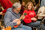 WOODBURY, CT. 03 January 2020-010320BS269 - Dorothy Ney of Waterbury, right, lots on as Javier Gonzalez of Waterbury strums on his ukulele, as the Woodbury Ukulele Band kicks off another season with a jam session at the Woodbury Senior Center on Friday. Bill Shettle Republican-American