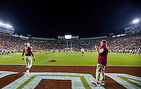 TALLAHASSEE, FLA. 9/5/15-Florida State quarterback Everett Golson, left, warms up for his debut as Head Coach Jimbo Fisher surveys the field prior to the Texas State University at Doak Campbell Stadium in Tallahassee.<br /> <br /> COLIN HACKLEY PHOTO