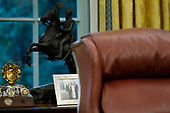 A framed photo of United States President Donald J. Trump's children, including Donald Trump Jr, White House Senior Advisor Ivanka Trump, and Eric Trump resides on a display table behind the resolute desk inside of the Oval Office on September 5, 2019, at the White House in Washington.<br /> Credit: Tom Brenner / Pool via CNP