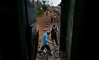 HAVANA, CUBA - APRIL 5: Cuban man passes with his bike at the Ciego de Avila station next to the train of Havana to Santiago de Cuba on April 5, 2018.. in Cuba. Ferrocarriles de Cuba, is one of the oldest railroad around world, having opened its first route in 1837 with at least 17-mile long. Now the railway probably could cover more than 2,600 miles along the Island.  (Photo by Eliana Aponte/VIEWpress)
