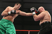Tyson Fury (Manchester, green shorts) defeats Daniel Peret (Norway, black shorts) in a Heavyweight boxing contest at Norfolk Showground, Norwich, promoted by Hennessy Sports - 01/03/09