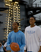 University of North Carolina basketball players Dexter Strickland, left, and John Henson, right, practice Thursday, November 10, 2011 aboard the Nimitz-class aircraft carrier USS Carl Vinson (CVN 70) in San Diego, California. Carl Vinson is hosting the Michigan State Spartans and the University of North Carolina Tar Heels for the inaugural Quicken Loans Carrier Classic basketball game on Veteran's Day, November 11.  United States President Barack Obama and first lady Michelle Obama are scheduled to attend the game..Mandatory Credit: Karolina A. Martinez - U.S. Navy via CNP