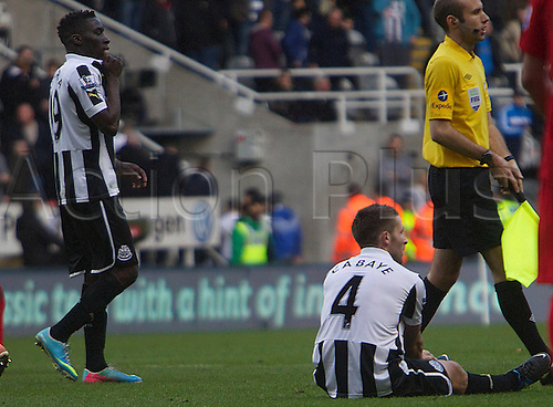 27.04.2013 Newcastle England.    Newcastle's Yohan Cabaye  sits dejected at full time during the English Premier league game between Newcastle United and Liverpool,  From The Sports Direct Arena, St James Park, Stadium, Newcastle.