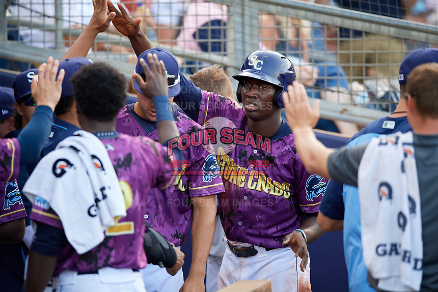 Charlotte Stone Crabs right fielder Jesus Sanchez (4) high fives with teammates in the dugout a game against the Palm Beach Cardinals on April 21, 2018 at Charlotte Sports Park in Port Charlotte, Florida.  Charlotte defeated Palm Beach 5-2.  (Mike Janes/Four Seam Images)