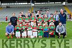 The Kilcummin NS team with their heroes Aidan O'Mahon, Paul Murphy and Tom Spillane at the Killarney Garda National School football blitz in Fitzgerald Stadium on Thursday