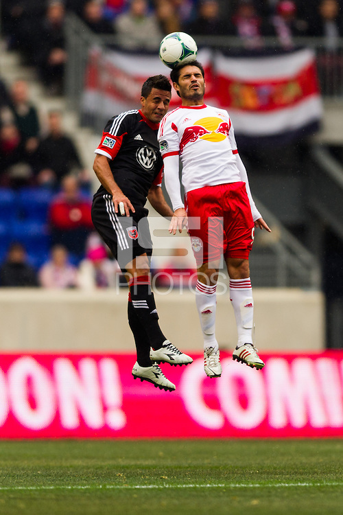 Marcelo Saragosa (11) of D. C. United goes up for a header with Fabian Espindola (9) of the New York Red Bulls. The New York Red Bulls and D. C. United played to a 0-0 tie during a Major League Soccer (MLS) match at Red Bull Arena in Harrison, NJ, on March 16, 2013.