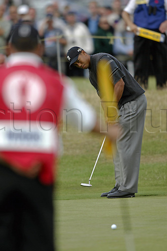 15 July 2004: American golfer Tiger Woods (USA) putts on the 14th green during the first round of The Open Championship played at Royal Troon, Scotland. Photo: Glyn Kirk/Action Plus...golf putter putting 040715.British