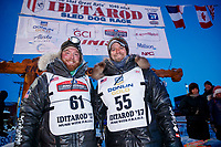 Matthew Failor and Michael Baker in the finish chute in Nome during the 2017 Iditarod on Saturday March 18, 2017.<br /> <br /> Photo by Jeff Schultz/SchultzPhoto.com  (C) 2017  ALL RIGHTS RESERVED