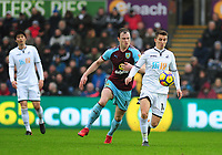 Burnley's Ashley Barnes battles with Swansea City's Tom Carroll<br /> <br /> Photographer Ashley Crowden/CameraSport<br /> <br /> The Premier League - Swansea City v Burnley - Saturday 10th February 2018 - Liberty Stadium - Swansea<br /> <br /> World Copyright &copy; 2018 CameraSport. All rights reserved. 43 Linden Ave. Countesthorpe. Leicester. England. LE8 5PG - Tel: +44 (0) 116 277 4147 - admin@camerasport.com - www.camerasport.com