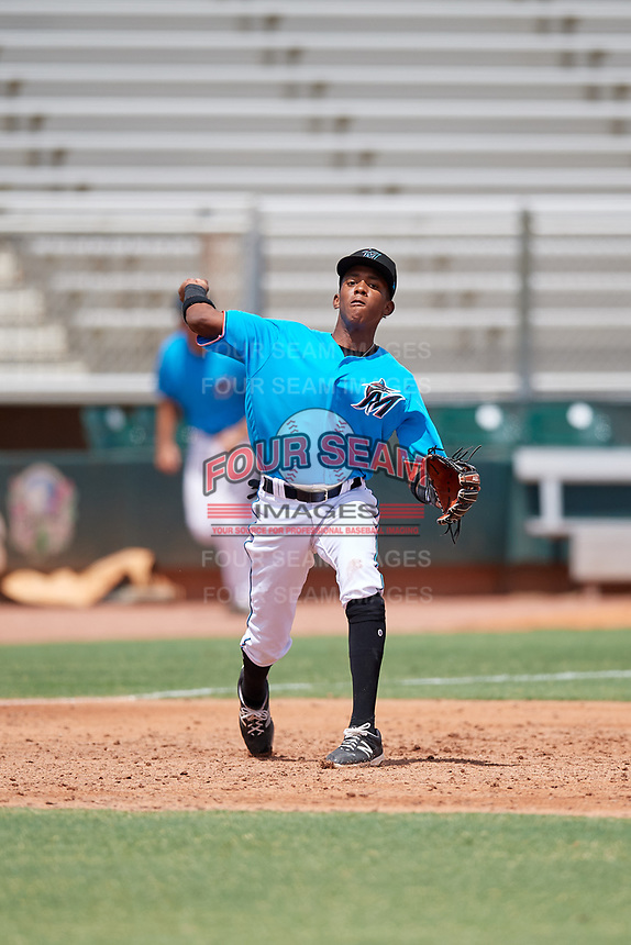 Miami Marlins third baseman Isaac De Leon (65) throws to first base during an Instructional League game against the Washington Nationals on September 25, 2019 at Roger Dean Chevrolet Stadium in Jupiter, Florida.  (Mike Janes/Four Seam Images)