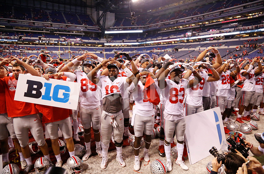 "The Ohio State Buckeyes sing ""Carmen Ohio"" following the Buckeyes' 27-21 victory against the Wisconsin Badgers during the Big Ten Football Championship on Saturday, December 2, 2017 at Lucas Oil Stadium in Indianapolis. [Joshua A. Bickel/Dispatch]"
