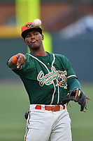 Shortstop Garvis Lara (28) of the Greensboro Grasshoppers warms up before a game against the Greenville Drive on Tuesday, April 25, 2017, at Fluor Field at the West End in Greenville, South Carolina. Greenville won, 5-1. (Tom Priddy/Four Seam Images)