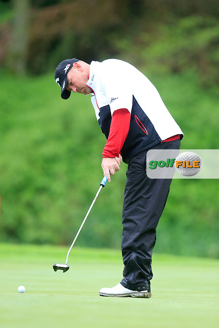 Thomas Bjorn (DEN) putts on the 17th green during Thursday's Round 1 of the 2016 Dubai Duty Free Irish Open hosted by Rory Foundation held at the K Club, Straffan, Co.Kildare, Ireland. 19th May 2016.<br /> Picture: Eoin Clarke | Golffile<br /> <br /> <br /> All photos usage must carry mandatory copyright credit (&copy; Golffile | Eoin Clarke)