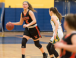 WATERBURY,  CT-021819JS24-  Watertown's Jordyn Forte (5) looks to pass while being guarded by Holy Cross' Hannah Brown (11) during their NVL semi-final game Monday at Kennedy High School in Waterbury. <br /> Jim Shannon Republican American