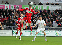 ATTENTION SPORTS PICTURE DESK<br /> Pictured: Matthew Bates of Middlesbrough (L) heads the ball away, Craig Beattie of Swansea (R) watches on<br /> Re: npower Championship, Swansea City FC v Middlesbrough Football Club at the Liberty Stadium, south Wales. Sunday 14 November 2010