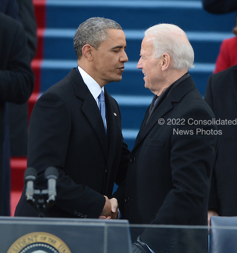 U.S. President Barack Obama shakes hands with Vice President Joe Biden after being sworn-in for a second term as the President of the United States by Supreme Court Chief Justice John Roberts during his public inauguration ceremony at the U.S. Capitol Building in Washington, D.C. on January 21, 2013.   .Credit: Pat Benic / Pool via CNP