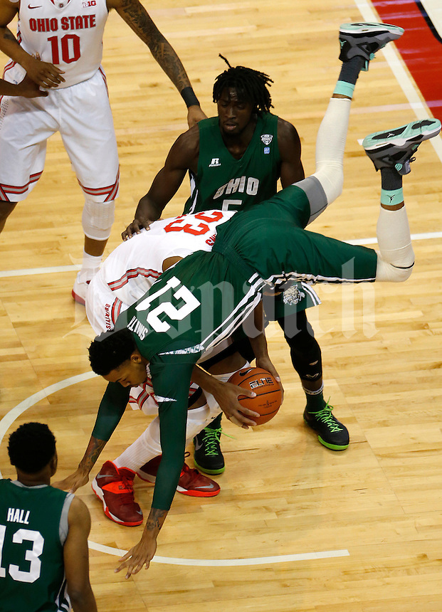 Ohio Bobcats forward Jon Smith (21) collapses on Ohio State Buckeyes guard Amedeo Della Valle (33) in the first half of the college basketball game between the Ohio State Buckeyes and the Ohio Bobcats at Value City Arena in Columbus, Tuesday evening, November 12, 2013. As of half time the Ohio State Buckeyes led the Ohio Bobcats 40 - 28. This was the first meeting of the teams in 19 years and the first ever game between them at Value City Arena. (The Columbus Dispatch / Eamon Queeney)
